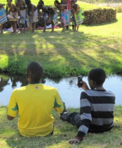 Youths taking photographs