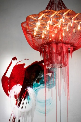 One of Adam Hoets' designer lamps seen against a Caro Allum abstract painting Source: Artslink.co.za