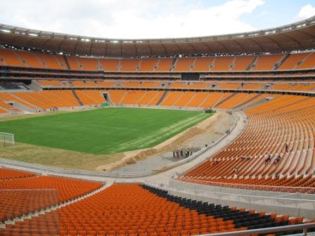 Stadium showing 4 dark lines in seating aligned in direction of 4 other stadia