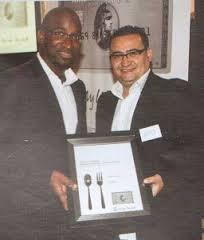 Emilio Coelho receives the American Express Fine Dining renewal reward for Osteria Tre Nonni