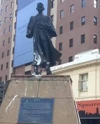 Gandhi Square: Statue of Gandhi in his legal robes