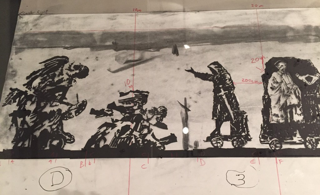 Preparatory layout showing placement of figures and measurements with the cracking Winged Victory on the left