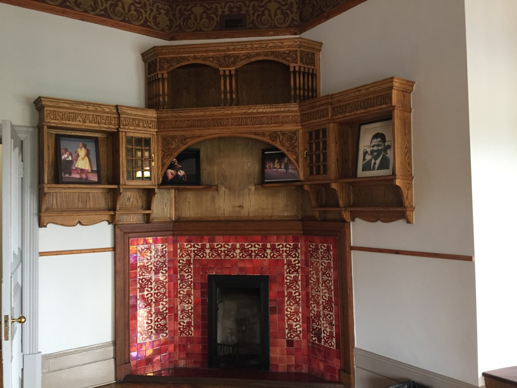 Library with book cases and fireplace and Bacon's carved mottoes