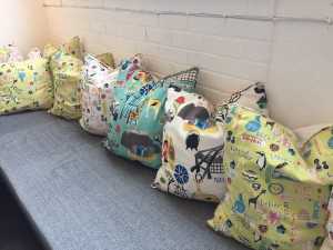Stunning cushions made with locally designed fabrics are also for sale